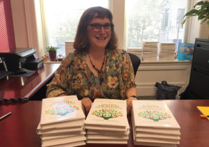 Beth with copies of the networked nonprofit on a desk in front of her