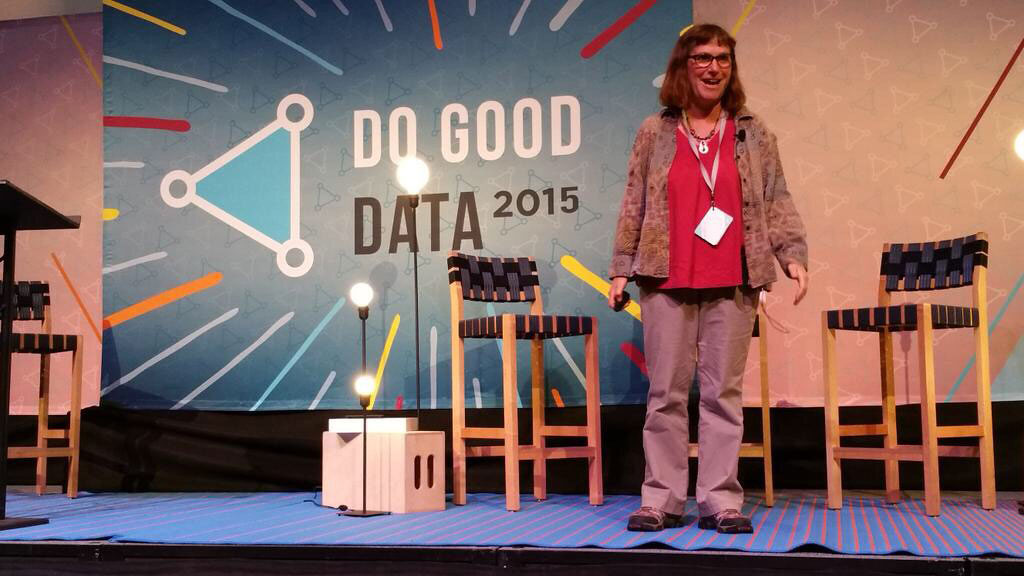 Beth on stage speaking at Do Good Data conference in 2015